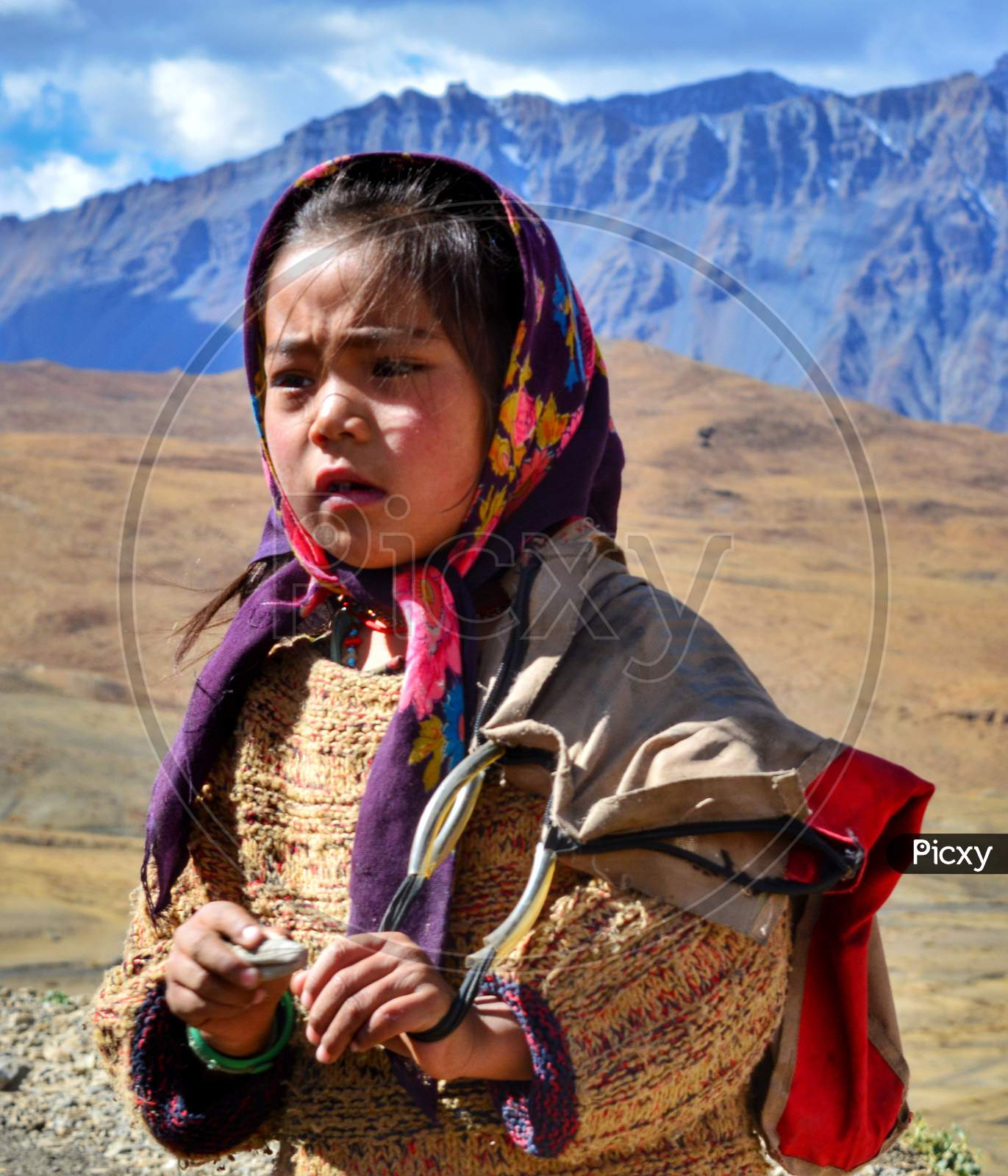 Portrait photo of a small village girl in Spiti valley
