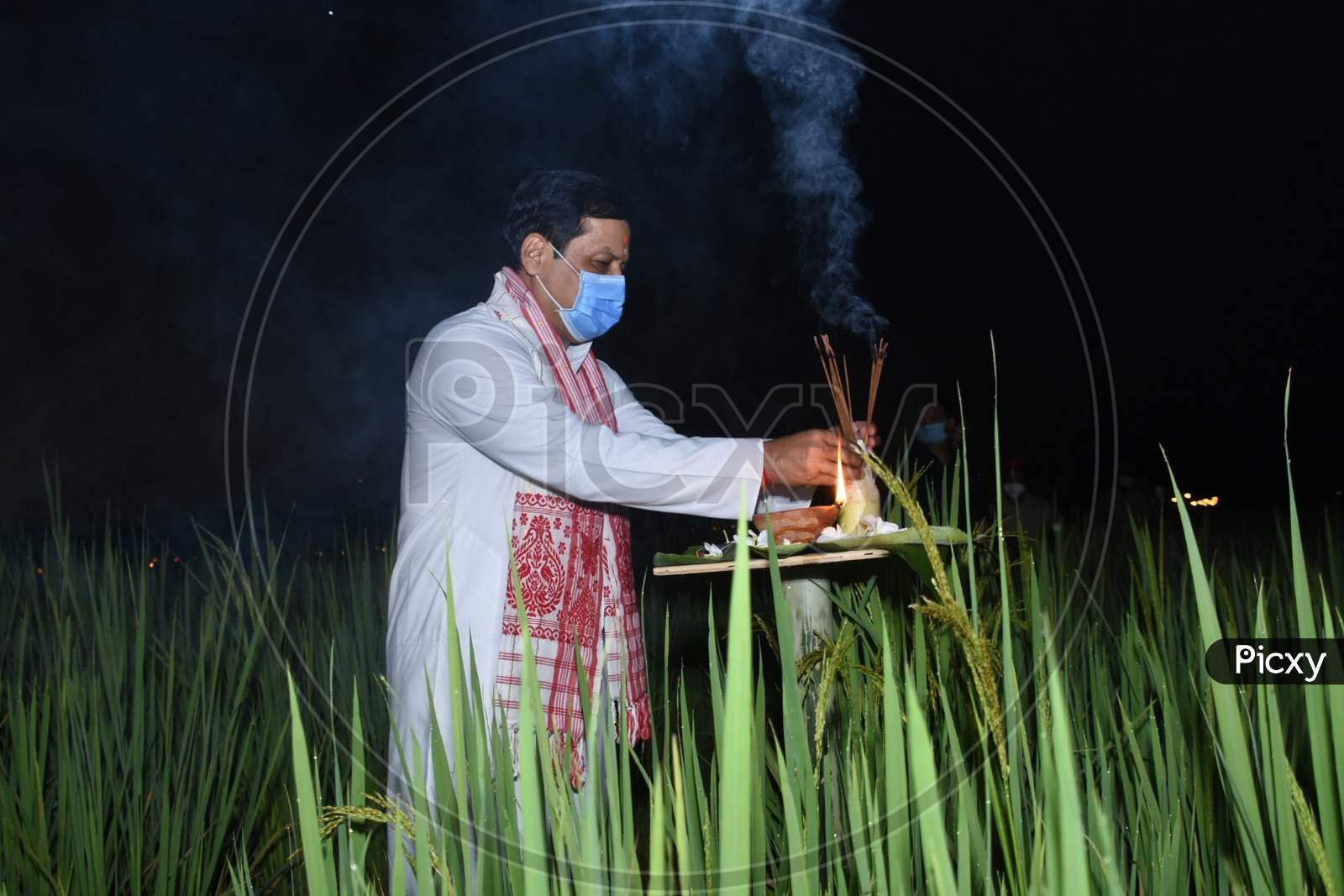 Assam Chief Minister Sarbananda Sonowal lighting akashbanti (earthen lamp) at a paddy field on the occasion of Kati Bihu at Bamunpara Monpur Pathar in Mangaldoi, in  Darrang district of Assam on oct 17,2020.