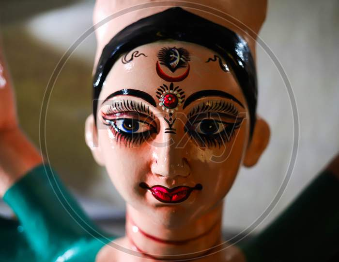 An artist giving final touches to the idol of Hindu Goddess Durga ahead of Durga Puja festival in CR Park, New Delhi on October 19, 2020. Bengalis all over the world celebrate an annual Durga puja festival.