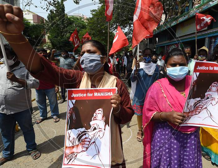 Communist Party of India (Marxist) activists stage a protest against the death of a 19-year-old woman in Hathras, in Chennai, Friday, Oct. 2,