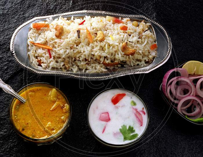 Vegetable Biryani-Kurma-Raita-Salad