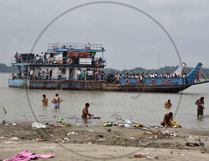 People cross the river Brahmaputra by ferryboat in Guwahati On Oct 22,2020.