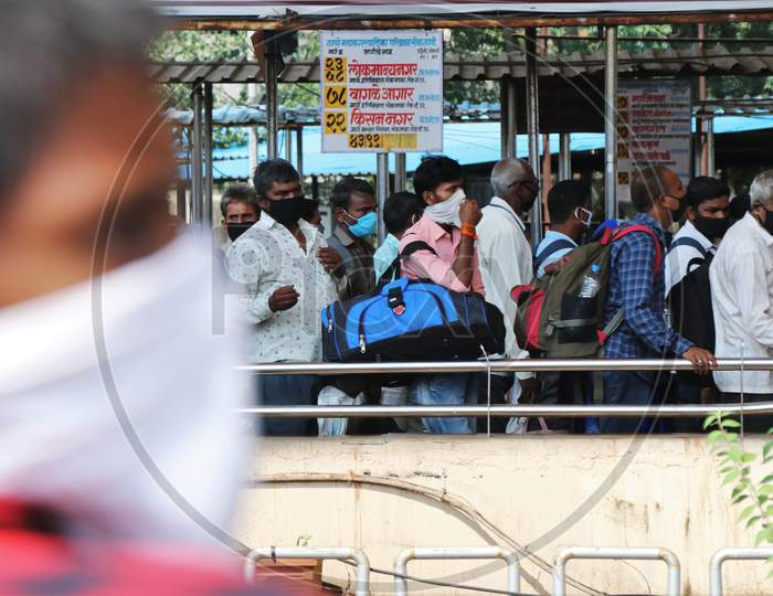 Migrants who returned from their hometown, wait to be tested for the coronavirus disease (COVID-19) during a rapid antigen testing campaign at a railway station, in Mumbai, India, October, 2020.