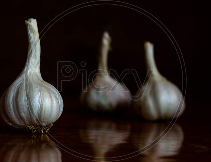 Raw Garlic Kept On The Table