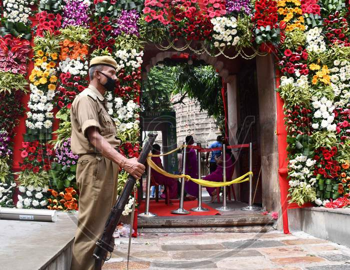 Security personal keep vigil outside the Kamakhya temple  on the occasion  of the Navratri festival, in Guwahati on Oct 22,2020.