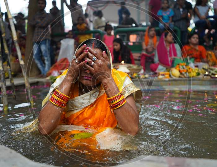 New Delhi, Delhi/ India- October 24 2020 : Women Of India Celebrating Chhath Pooja By Drowning Themselves In Water For Praying To Sun.