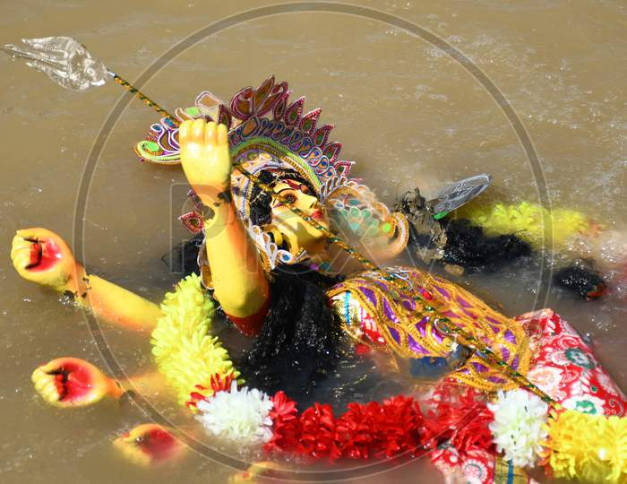 Hindu goddess Durga into the brahmaputra  river during the immersion ceremony of Durga Puja in Guwahati on oct 26,2020