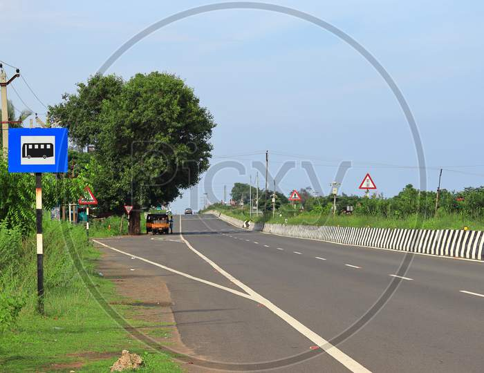 Beautiful National Highway Road Landscape Images With Bus Stop Road Signal