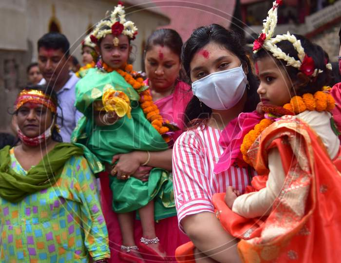 """Hindu devotees carry girls dressed as the Hindu goddess Durga for the """"Kumari"""" puja rituals during the Durga Puja festival at the Kamakhya Temple in Guwahati on oct 25,2020."""