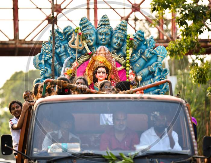 Devotees bring Idols of Goddess Durga for immersion in Hussain Sagar on the last day of Durga Puja/Dasara/Navratri in Hyderabad on October 26, 2020.
