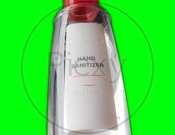 Closeup Of Hand Sanitizer Bottle Isolated On Green Background