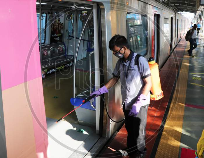 A worker sanitizes a coach as the metro network prepares to resume services after more than a 6-month shutdown due to the Covid-19 coronavirus pandemic, at the Andheri metro station in Mumbai, October, 2020.