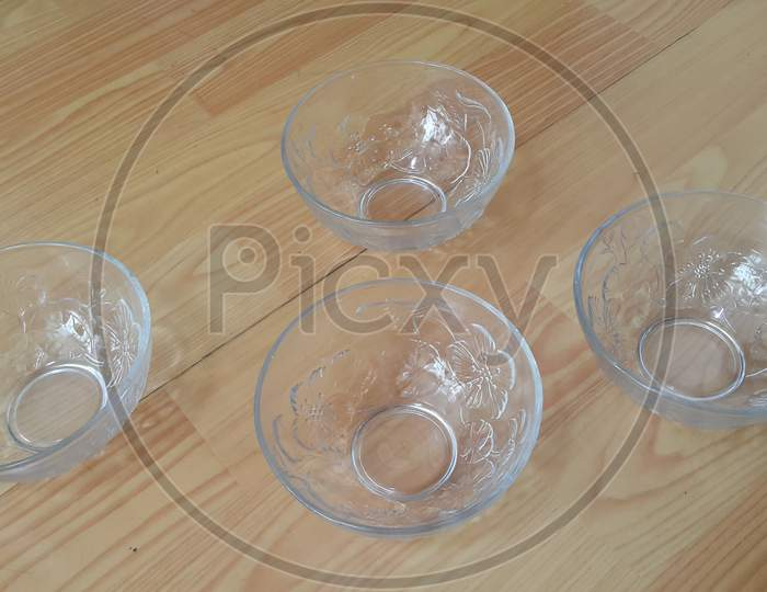 Top View Of Empty White Glass Bowls On A Wooden Floor