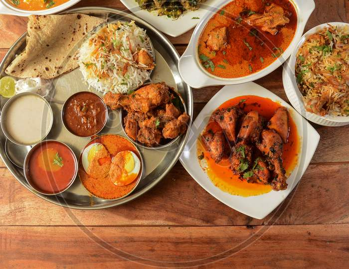Assorted Indian Foods Pepper Chicken Gravy,Chicken Masala And Nonveg Thali On Wooden Background. Dishes And Appetizers Of Indian Cuisine