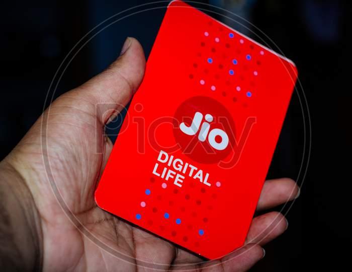Jio Sim Cards In Hand With Every Jiofi Or 4G Smartphone