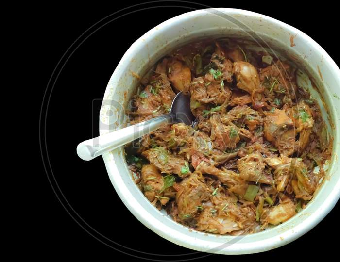 Delicious Chicken Dry Curry In A Bowl With Spoon Black Background