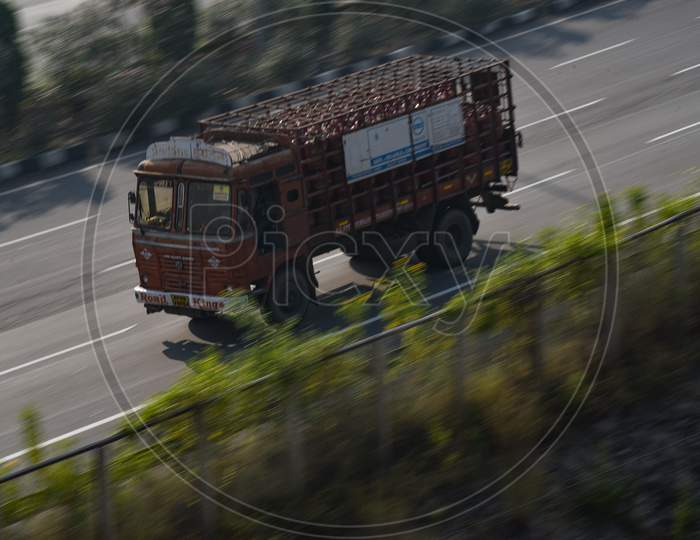 a fast moving Lorry on the Highway in Hyderabad