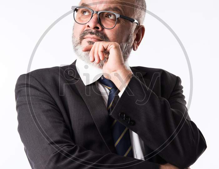 Portrait Of Indian Asian Thoughtful Senior Businessman In Suit