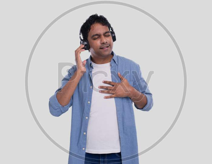 Indian Man Listening To Music. Man Listening Music. Enjoys The Melody. Man Isolated