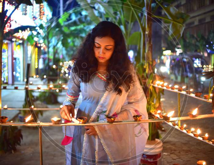 A girl  light lamps on the occasion of Diwali festival in Nagaon District of Assam on Nov 14,2020.