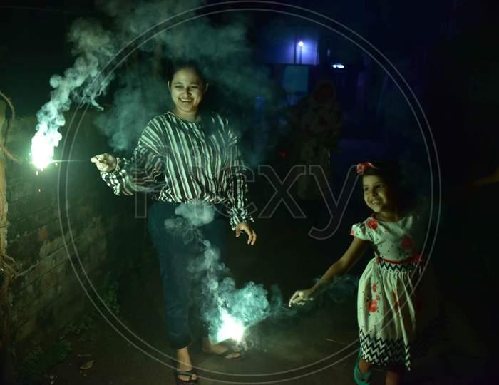 Girls hold sparklers during Diwali celebrations in Nagaon District of Assam on Nov 14,2020.