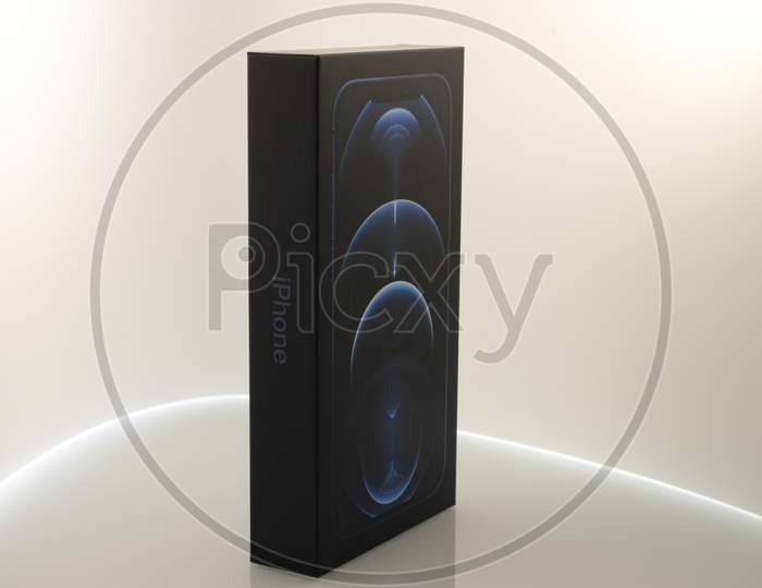 Frankfurt, Germany - November 13th 2020: A german photographer bought the new iPhone 12 Pro Max in the color Pacific Blue, taking pictures of the unboxing after it was delivered.