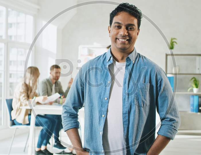 Indian Man Smilling At Work Portrait. Man In Creative Office. Sunny Day At Work In Office.