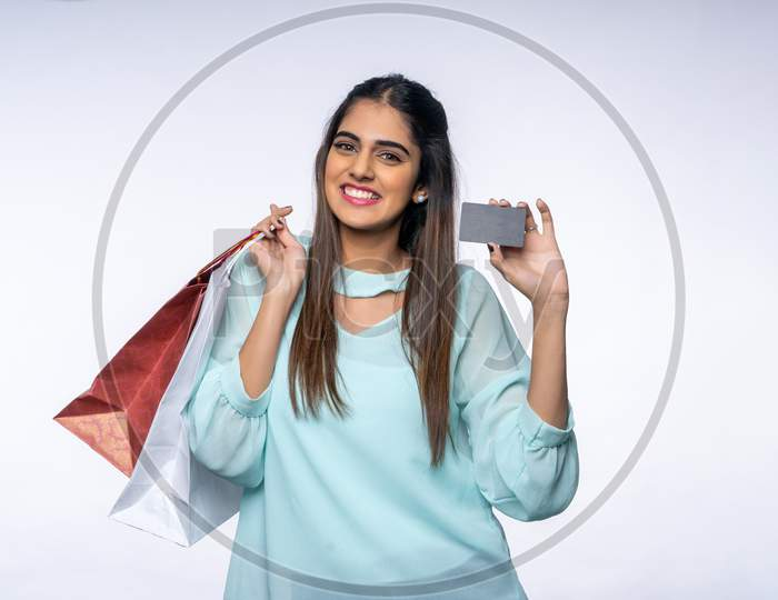 Indian young woman with a Card and Shopping bags