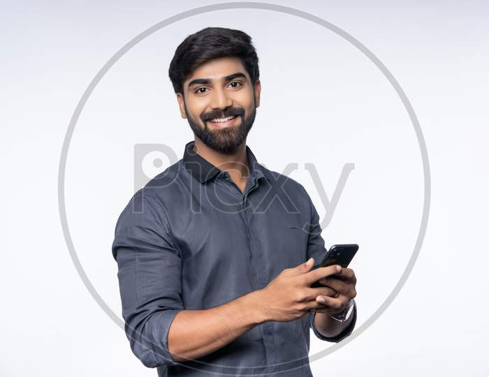 Young Indian Man using smartphone