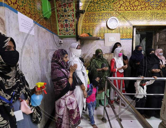 Women wearing protective masks pray inside a shrine after religious places reopened for the public amid the spread of the coronavirus disease (COVID-19) in Mumbai, India in November, 2020.