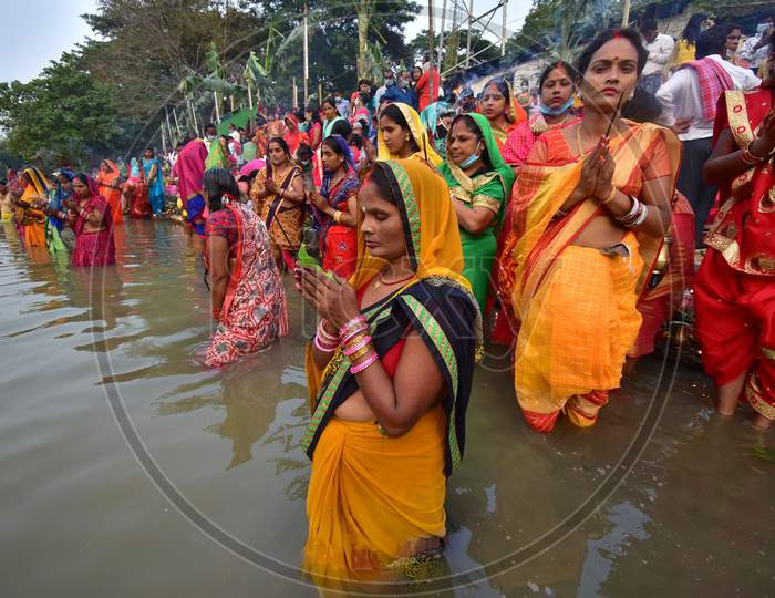 Hindu devotees offer prayers to the Sun on the occasion of Chhath Puja festival in Nagaon district, in the northeastern state of Assam on Nov 20,2020