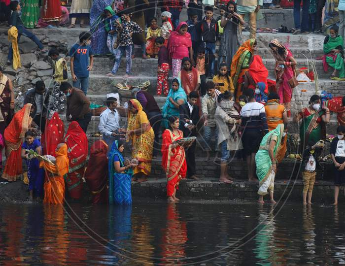 Hindu devotees perform rituals during the Chhath festival in New Delhi- Ghaziabad border on November 20, 2020.