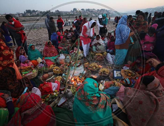 Devotees perform rituals during 'Chhath Puja' celebrations, on the banks of River Tawi in Jammu, Saturday, Nov. 21, 2020.