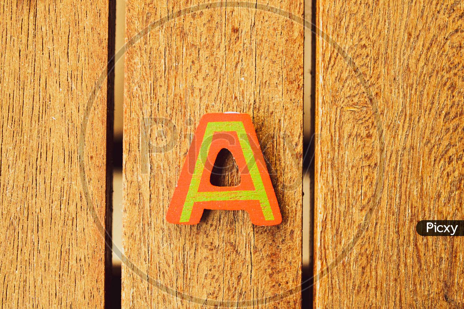A  Letters On Wood Background