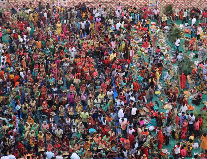 Hindu devotees worship the Sun god in an artificial pond during the religious festival of Chhath Puja, amid the spread of the coronavirus disease (COVID-19), in Mumbai, India on November 20, 2020.