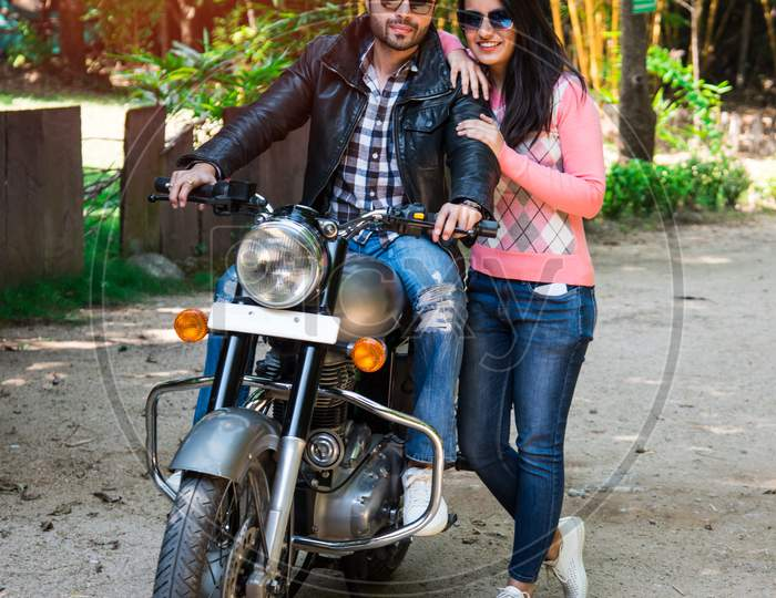 Asian Indian Happy Couple Riding On Motorbike