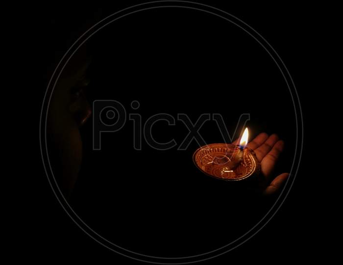 A Girl Holding Oil Lamp In Her Hands On The Occasion Of Hindu Festival Diwali