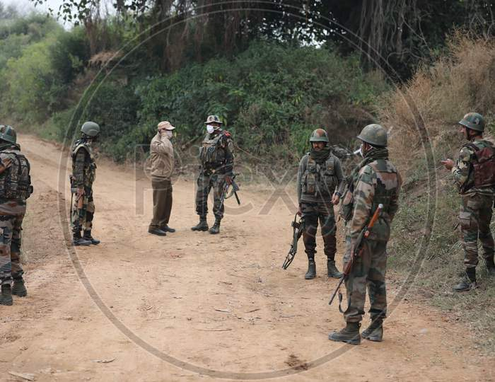 Security personel stand gurad beside an underground tunnel near the international border in Samba sector, suspected to have been used by terrorists killed in a recent encounter in Nagrota, in Jammu district, Sunday, Nov. 22, 2020.