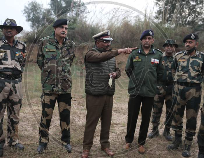 Police officers and Bsf inquire an underground tunnel near the international border in Samba sector, suspected to have been used by terrorists killed in a recent encounter in Nagrota, in Jammu district, Sunday, Nov. 22, 2020.