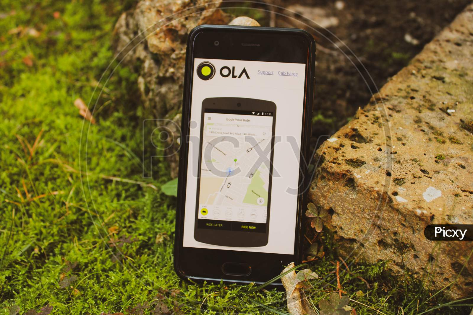 Ola App Booking Cabs From Smarthphon