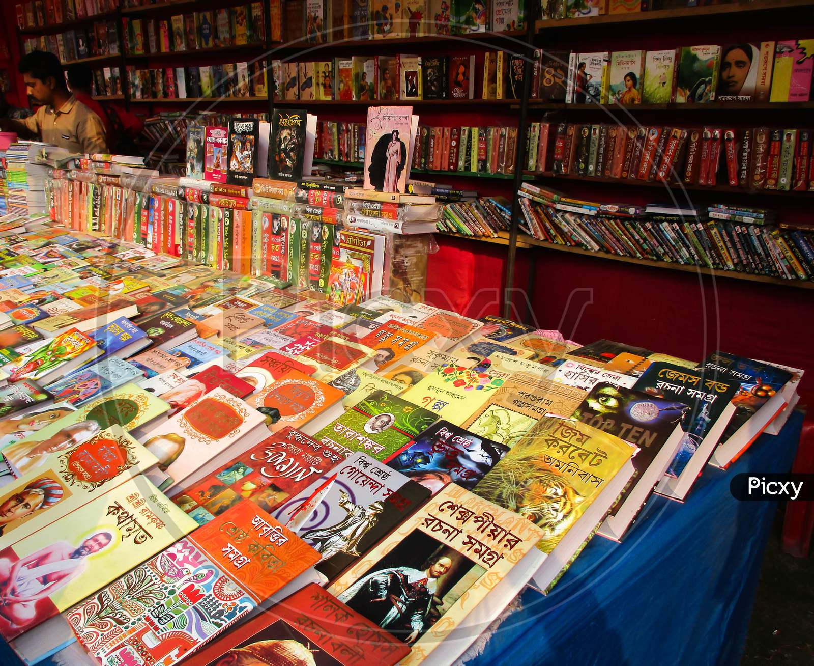 West Bengal , India March 02, 2020 : Indian Book Fair, There Are Many Bengali Books In The Fair Shop And The Store Keeper Placed Those Books With An Interesting View .