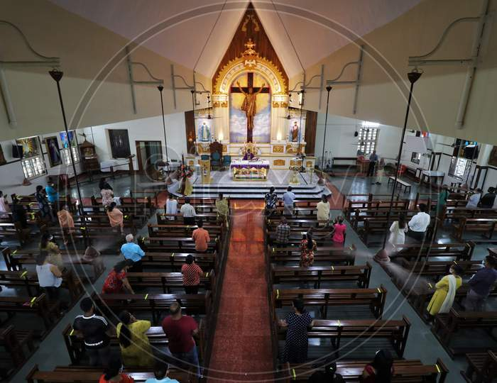 Devotees wearing protective masks attend Sunday mass at a church amid the spread of the coronavirus disease (COVID-19) in Mumbai, India, November 29, 2020.