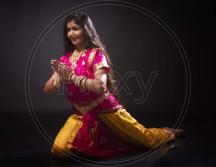 Indian woman performing classical Bharatanatyam dance
