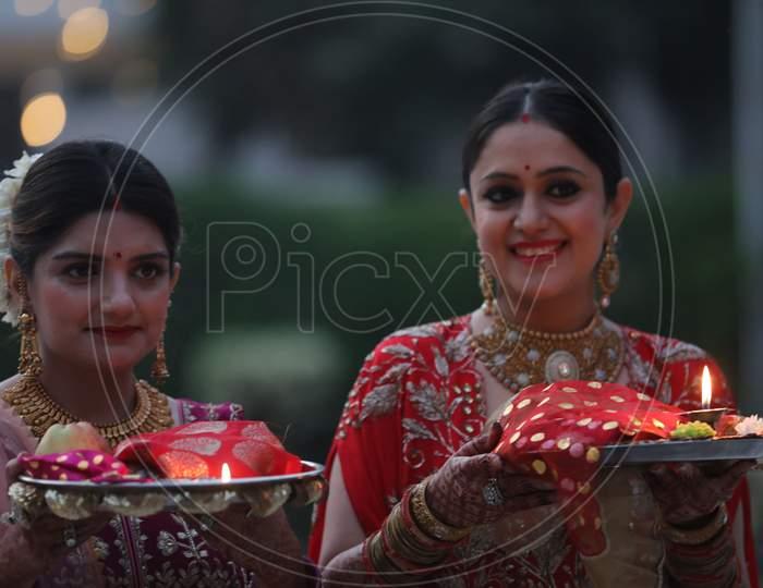 Married women perform rituals during 'Karwa Chauth' festival, in Jammu,4 November,2020.