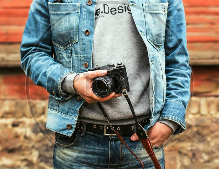 Man Holds A Old Camera