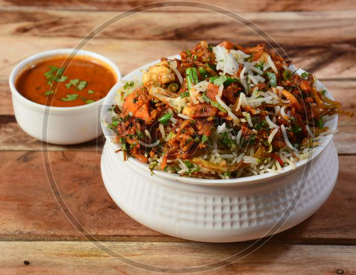 Traditional Hyderabadi Vegetable / Veg Dum Biryani With Mixed Veggies Served With Curry, Selective Focus