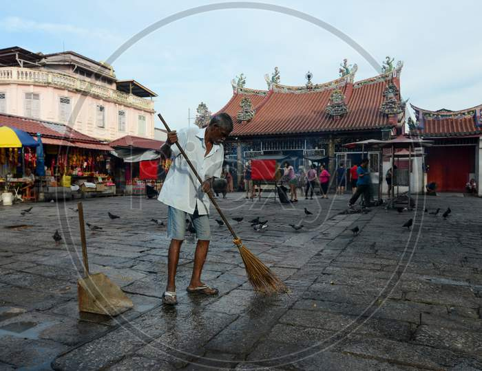 A India Man Clean The Floor At Goddess Of Mercy Temple