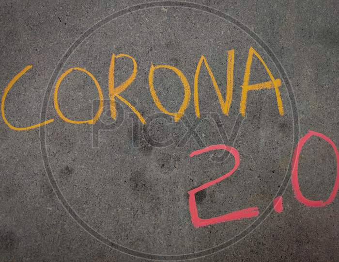 The Inscription Text On The Grey Board, Corona 2.0 Using Color Chalk Pieces.