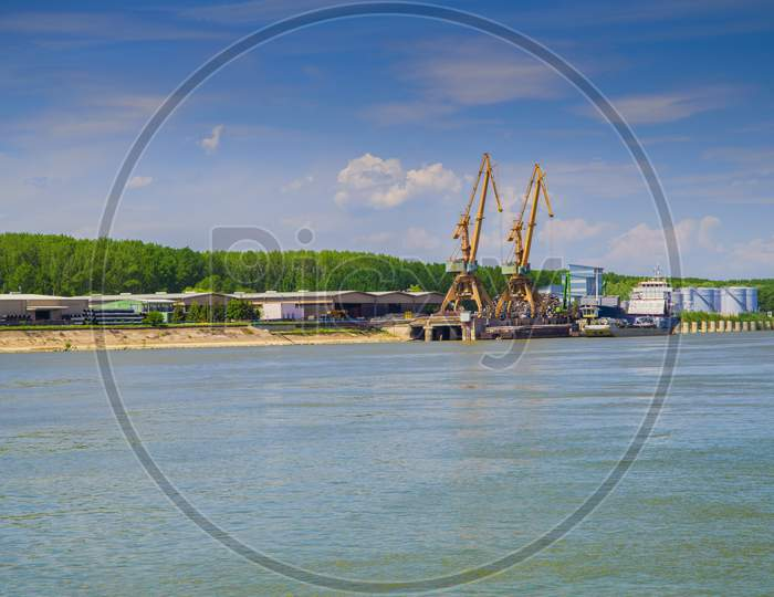 Shipyard With Cranes On Danube River