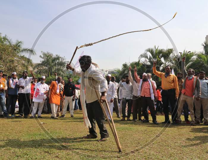 A man demonstrates his skills during a protest of farmers and members of various agricultural organisations against new farm laws passed by India's parliament, in Mumbai, India, December, 2020.